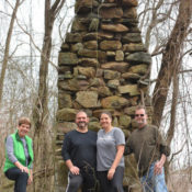 Earl Hawkins and family stand in front of old chimney