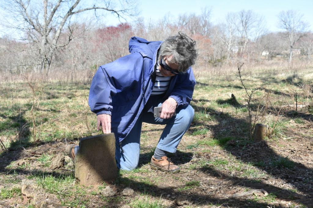 Judy Mahanes looks at headstone