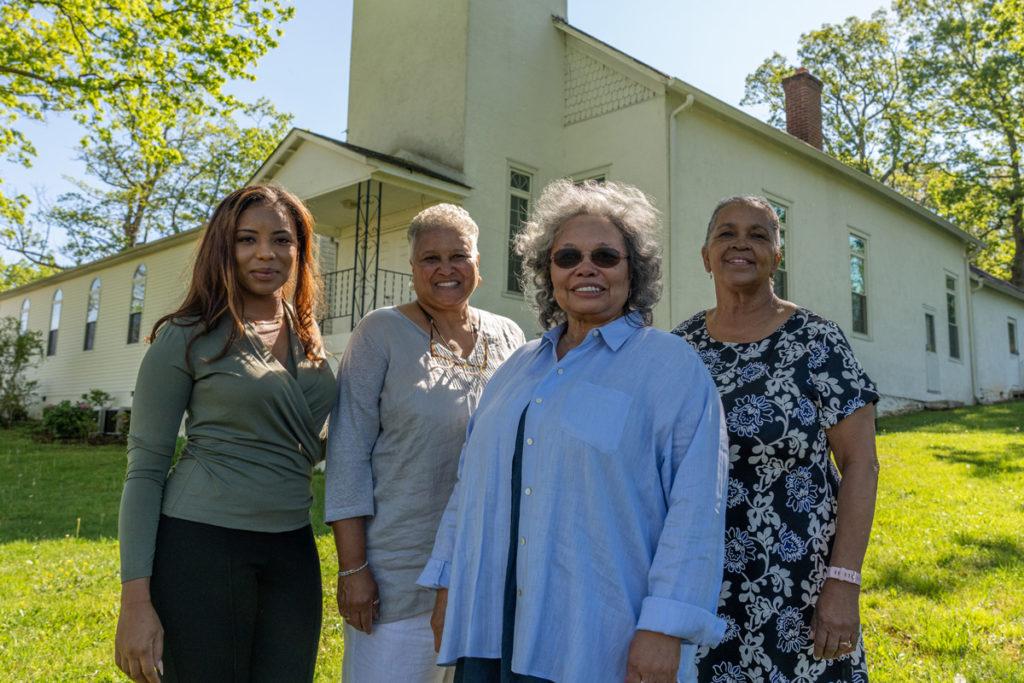 Aysha Davis, Karen Hughes White, Angela Davidson and Christine Lewis stand in front of the First Baptist Church