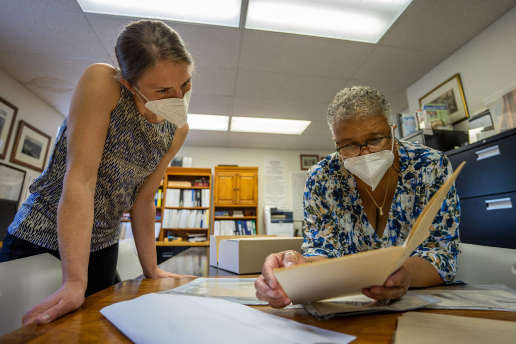 pec's kristie kendall looking at historic documents with karen hughes white