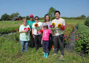 community farm volunteers with Dana Melby