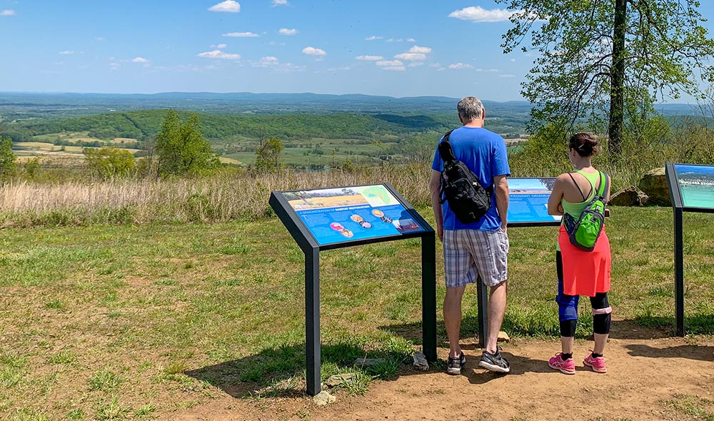 Hikers at Piedmont Memorial Overlook interpretive signs