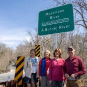 PEC Senior Conservation Fellow Kat Imhoff, Albemarle Supervisors Ann Mallek and Liz Palmer, and PEC board member John Birdsall stand beneath the new Moormans Scenic River sign.