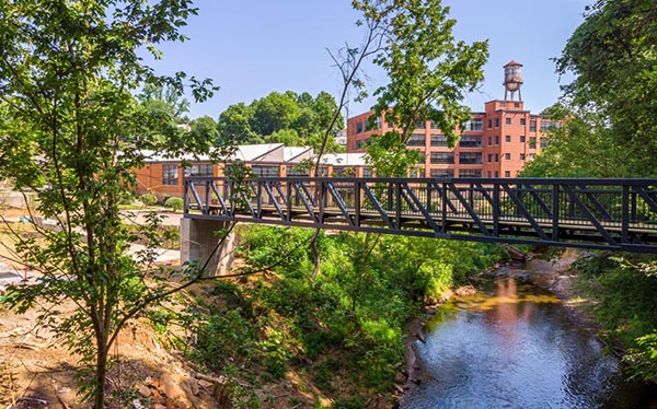 Connectivity Update / New Pedestrian Bridge Installed at Woolen Mills